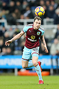 Ashley Barnes (#10) of Burnley heads the ball on during the Premier League match between Newcastle United and Burnley at St. James's Park, Newcastle, England on 31 January 2018. Photo by Craig Doyle.