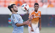 Jun 29, 2016; Houston, TX, USA; Sporting Kansas City midfielder Graham Zusi (8) traps the ball agains the Houston Dynamo in the fist half at BBVA Compass Stadium. Mandatory Credit: Thomas B. Shea-USA TODAY Sports