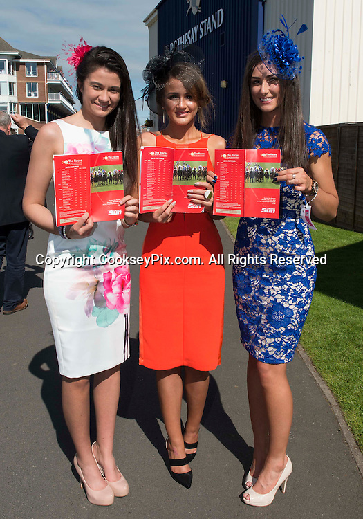 Picture by Christian Cooksey/CookseyPix.com<br /> Scottish Sun Raceday at Ayr racecourse. 20th June 2015.<br /> LtoR. Jill Cowie, jessica Grant and Cara Drummond all from Paisley with the Scottish Sun racecard.