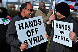 """4/6/2014 Allentown, PA. Nazih """"Nick"""" Zarif Mouhrez of Catasauqua (left) holds a protest sign. PA Members of the Lehigh Valley Syrian community gather at the corner of Airport Road and Union Boulevard in Allentown to protest against supporting terrorist groups in Syria. Photo 