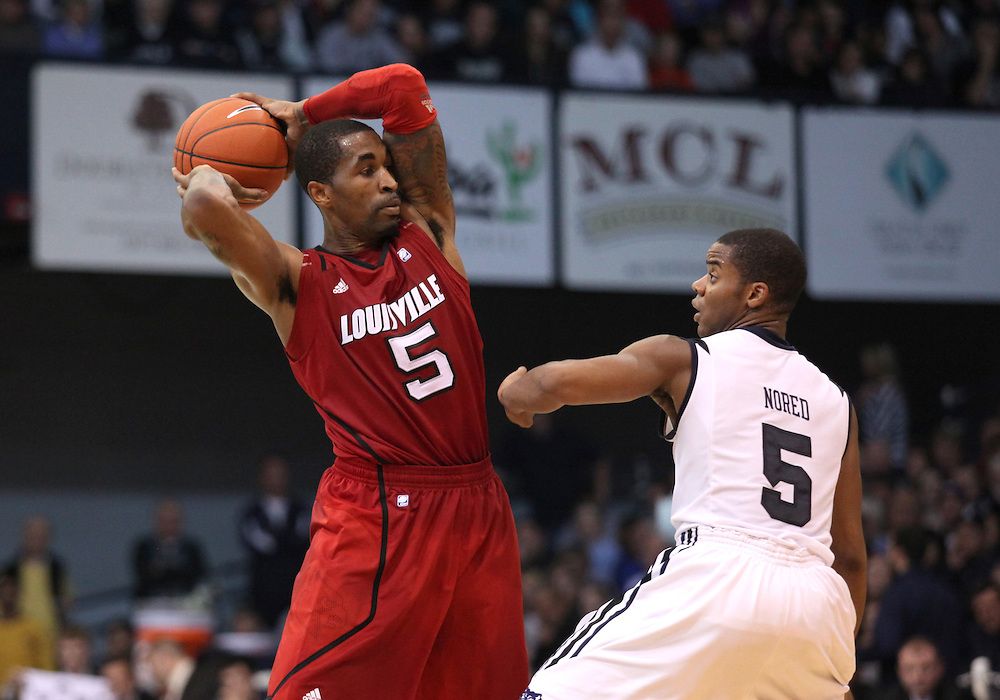 November 19, 2011: Louisville's Chris Smith looks to pass as Butler's Ronald Nored guards during the game at Hinkle Fieldhouse in Indianapolis, Ind. Louisville won 69-53.