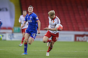 Oldham Athletic midfielder Carl Winchester  chases Sheffield United defender James McEveley  during the The FA Cup match between Sheffield Utd and Oldham Athletic at Bramall Lane, Sheffield, England on 5 December 2015. Photo by Simon Davies.