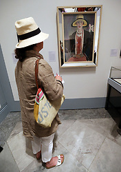 Image licensed to i-Images Picture Agency. 09/07/2014. London, United Kingdom. A visitor admires a portrait of the former Vogue Fashion Editor Madge Garland , who was called 'the woman who dressed Virginia Woolf' at a new exhibition on Virginia Woolf which opens on 10th July at the National Portrait Gallery in London.  Picture by Stephen Lock / i-Images
