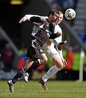 Photo. Jed Wee.<br /> Bolton Wanderers v Newcastle United, FA Barclaycard Premiership, Reebok Stadium, Bolton. 28/03/2004.<br /> Newcastle's Gary Speed (L) bravely heads the ball away from Bolton's Kevin Nolan's raised foot.