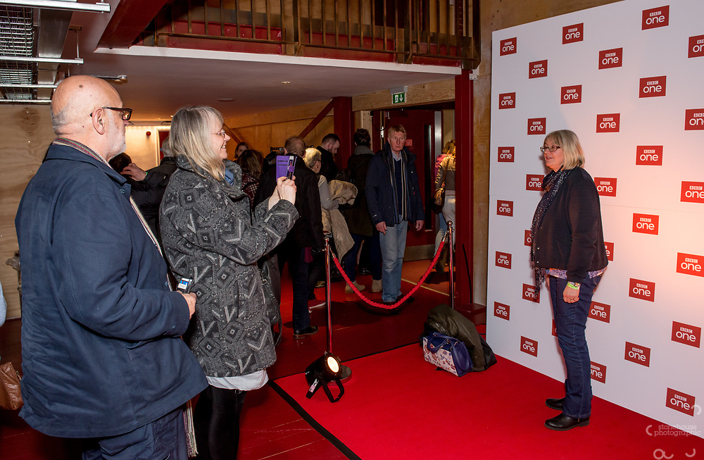 Members of the audience take photos on the BBC background after the special screening of BBC drama Shakespeare &amp; Hathaway &ndash; Private Investigators, is due to hit TV screens late February, 150 lucky people got the chance to view a private screening of the first episode.<br /> On Friday 9 February, The Other Place in Stratford-upon-Avon, an actual location featured in the drama, the venue to held the screening and, a special question and answer session hosted by Midlands Today presenter Rebecca Wood. She was joined by Jo Joyner, Mark Benton, Patrick Walshe McBride and the show&rsquo;s producer Ella Kelly.<br /> The ten-part drama from BBC Studios, created by Paul Matthew Thompson and Jude Tindall, will see Frank Hathaway (Benton), a hardboiled private investigator, and his rookie sidekick Luella Shakespeare (Joyner), form the unlikeliest of partnerships as they investigate the secrets of rural Warwickshire&rsquo;s residents.<br /> Beneath the picturesque charm lies a hotbed of mystery and intrigue: extramarital affairs, celebrity stalkers, missing police informants, care home saboteurs, rural rednecks and murderous magicians. They disagree on almost everything, yet somehow, together, they make a surprisingly effective team &ndash; although they would never admit it.<br /> Will Trotter, head of BBC Daytime Drama at the BBC Drama Village, comments, &ldquo;For years we have been producing quality drama at the BBC Drama Village, and Shakespeare &amp; Hathaway is no different. It&rsquo;s the perfect programme to indulge in, and like many of the programmes that we make in Birmingham, we&rsquo;ve been out and about in the county to film in some of the best locations the Midlands has to offer. <br /> &ldquo;We&rsquo;re looking forward to seeing the audience reactions to the first episode, it&rsquo;s got a whodunit storyline with a brilliant introduction to the main characters, but leaves you with some questions which makes the audience want to come back for more!&rdquo; <br /> Notes to editors<br /> For more information on the series you can contact hollie.dr