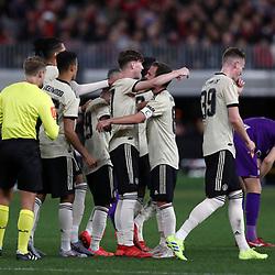 James Garner of Manchester United celebrates scoring a goal