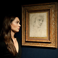 London October 20th  A Christie's employee poses in front of Head of a Muse by Raphael . The drawing wil go under the hammer for the first time in over 150 years on the 8th of December 2009 and is expected to sell for around  12-16 millions...***Agreed Fee's Apply To All Image Use***.Marco Secchi /Xianpix. tel +44 (0) 771 7298571. e-mail ms@msecchi.com .www.marcosecchi.com