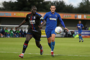 AFC Wimbledon midfielder Dylan Connolly (16) battles for possession with Crystal Palace Mamadou Sakho (12) during the Pre-Season Friendly match between AFC Wimbledon and Crystal Palace at the Cherry Red Records Stadium, Kingston, England on 30 July 2019.