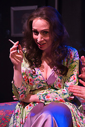 © Licensed to London News Pictures. 26/01/2016. London, UK. Rebecca Vaughan as Lauretta Feldman. Monty Python's Terry Jones directs Jeepers Creepers, a play about the powerful and complex partnership between Marty Feldman and his wife Lauretta. The comedy was written by Marty's biographer Robert Ross and is starring David Boyle as Marty Feldman and Rebecca Vaughan as Lauretta Feldman. Four-week run premiers at the Lounge at Leicester Square Theatre from 18 January to 20 February 2016. Photo credit: Bettina Strenske/LNP