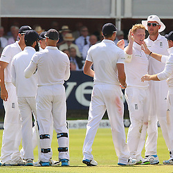 England players celebrate the wicket of India's Cheteshwar Pujara and England's Ben Stokes is congratulated during the first day of the Investec 2nd Test match between England and India at Lords, London, 17th July 2014 © Phil Duncan | SportPix.org.uk