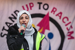 London, UK. 16th March, 2019. Naheela Ashraf of Manchester Stand Up To Racism addresses thousands of people on the March Against Racism demonstration on UN Anti-Racism Day against a background of increasing far-right activism around the world and a terror attack yesterday on two mosques in New Zealand by a far-right extremist which left 49 people dead and another 48 injured.