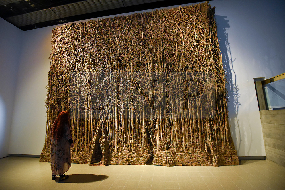 """© Licensed to London News Pictures. 02/03/2020. LONDON, UK. A staff member views """"Foret Palatine"""", 2019-20, by Eva Jospin. Preview of """"Among The Trees"""" exhibition at the Hayward Gallery on the Southbank.  Artworks by 38 international artists explore man's relationship with trees and forests at a time when the destruction of forests is accelerating in show which runs 4 March to 17 May 2020.  Photo credit: Stephen Chung/LNP"""
