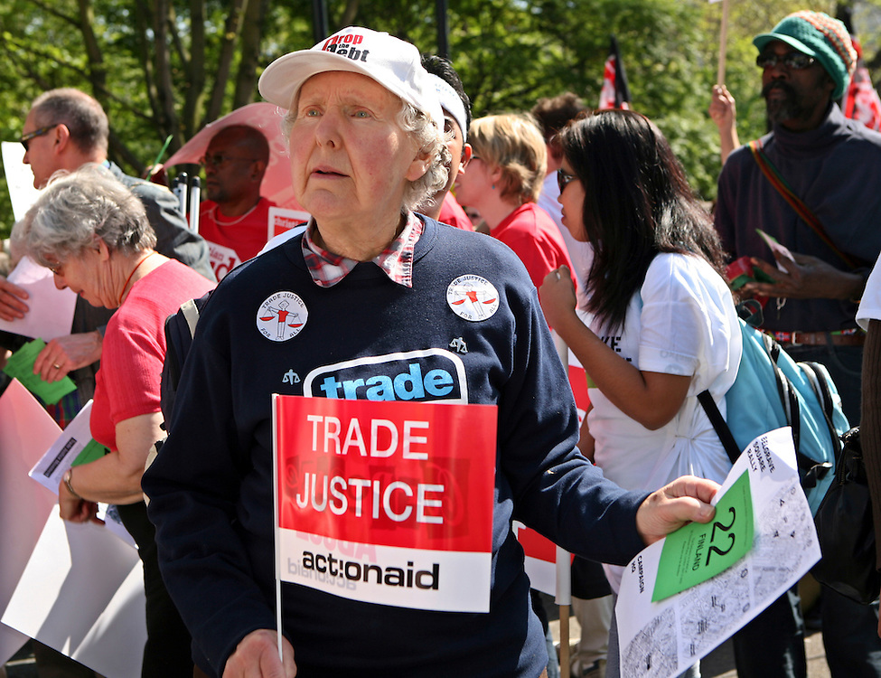 Trade Justice movement members gather to demonstrate outside the German embassy.