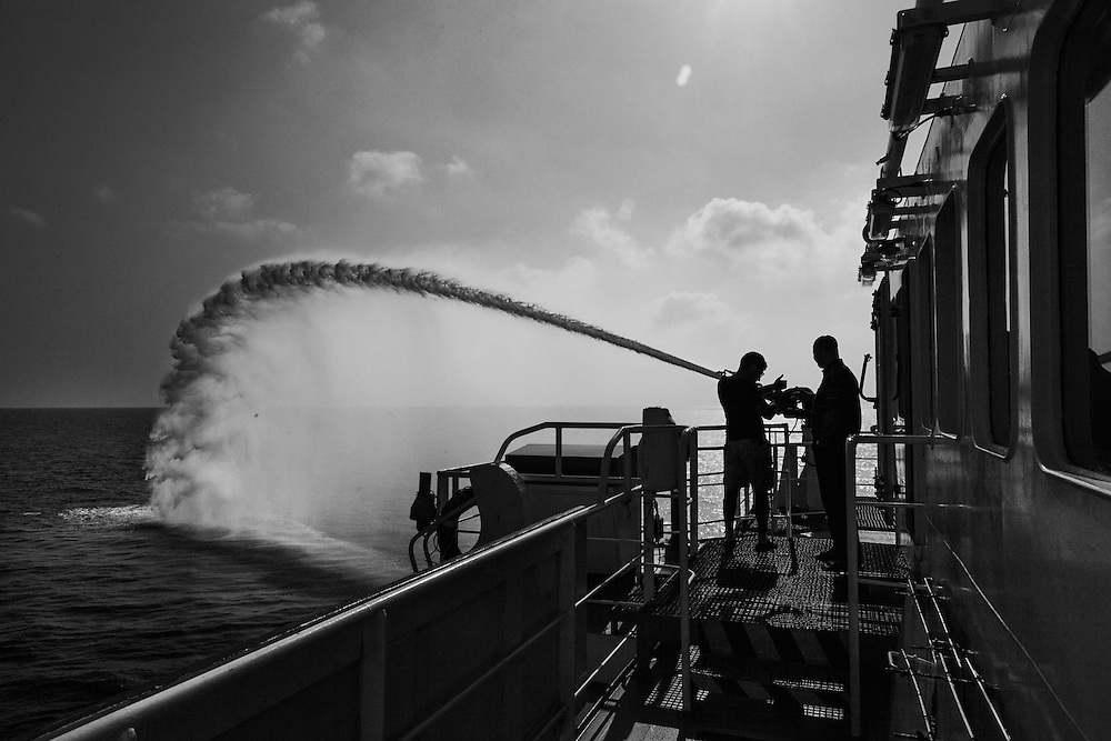 On board the MOAS Responder, sailing to S.A.R (Search And Rescue) zone.<br /> Pierre, Chief Mate, is testing water cannons.