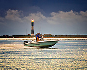 Double Whopper Fishing Boat leaves Captree and powers past the Fire Island Lighthouse, Long Island, New York