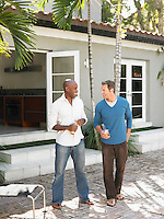Two men having conversation on patio