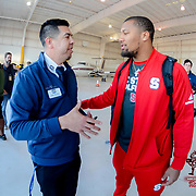 Bradley Chubb of the North Carolina State Wolfpack greets Media Director Eddie Morelos at the arrival in El Paso Texas for the 84th Annual Hyundai Sun Bowl. December 25, 2017