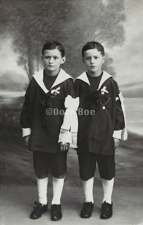 two boys posing commemorate their holy communion