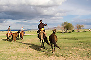 Horses and riders in the Mongolian Altai