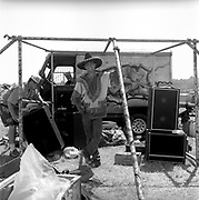 Member of Blim Bros in a sombrero standing by van whilst sound system is being set up, Glastonbury, Somerset, 1989