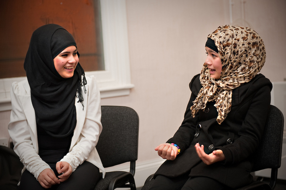Young Asian women in head scarves at a SPICES Young Women's Forum in Smethwick Library in Smethwick, West Midlands, Britain.