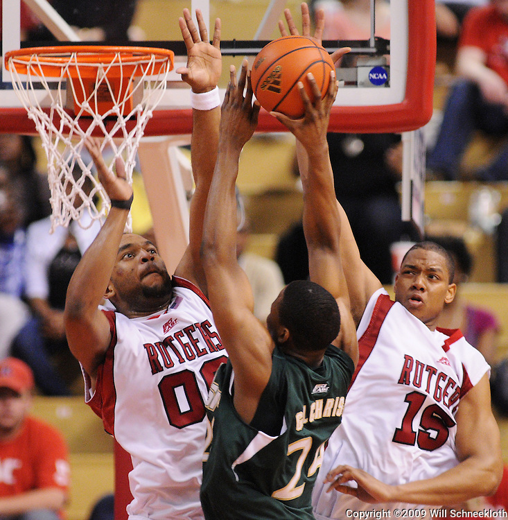 Mar 7, 2009; Piscataway, NJ, USA; Rutgers forward Gregory Echenique (00) and forward J.R. Inman (15) block a shot by South Florida forward Augustus Gilchrist (24) during the second half of Rutgers' senior day game against South Florida at the Louis Brown Athletic Center.  Rutgers won 45-42.