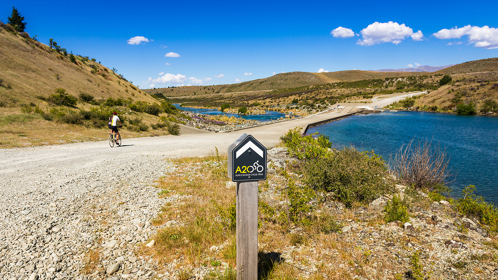 Cyclists on the Alps to Ocean Cycle Trail at Lake Ohau, Southern Alps, Canterbury, South Island, New Zealand