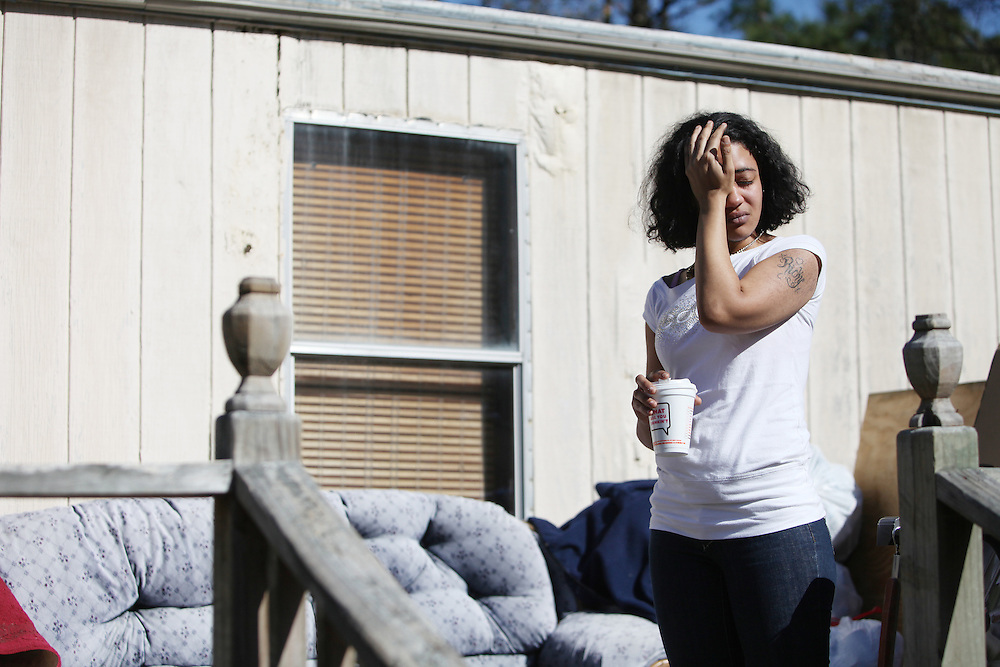ANDREW KNAPP/STAFF -- Jan. 25, 2012 -- Joy Tareece Holmes, 20, wipes tears from her eyes as she talks about her father, 40-year-old Leland B. Shannon Jr., outside the Lincolnville residence where he was fatally shot Tuesday morning during a home invasion.