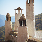 Chimneys on top of a building in Alpujarras de la Sierra, Spain, near the Sierra Nevada National Park.<br />