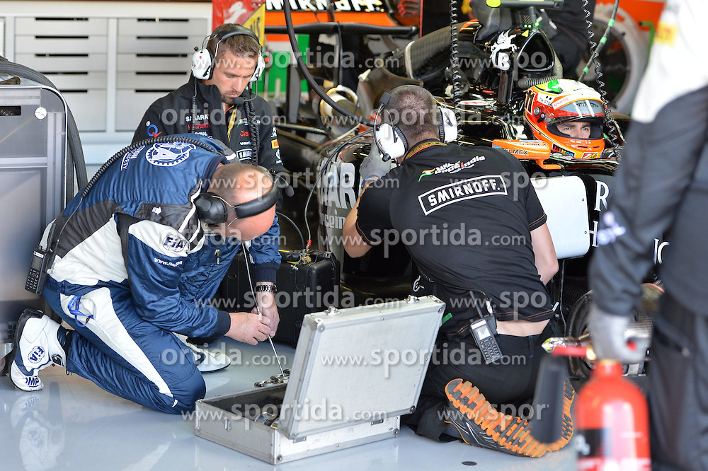04.07.2014, Silverstone Circuit, Silverstone, ENG, FIA, Formel 1, Grand Prix von Grossbritannien, Training, im Bild Sergio Perez (MEX) Force India VJM07 in the garage // during the practice of British Formula One Grand Prix at the Silverstone Circuit in Silverstone, Great Britain on 2014/07/04. EXPA Pictures &copy; 2014, PhotoCredit: EXPA/ Sutton Images<br /> <br /> *****ATTENTION - for AUT, SLO, CRO, SRB, BIH, MAZ only*****