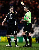 Photo: Paul Greenwood/Sportsbeat Images.<br />Preston North End v Cardiff City. Coca Cola Championship. 29/12/2007.<br />Cardiff's Steve McLean, (L) is yellow carded by referee Mr M Haywood