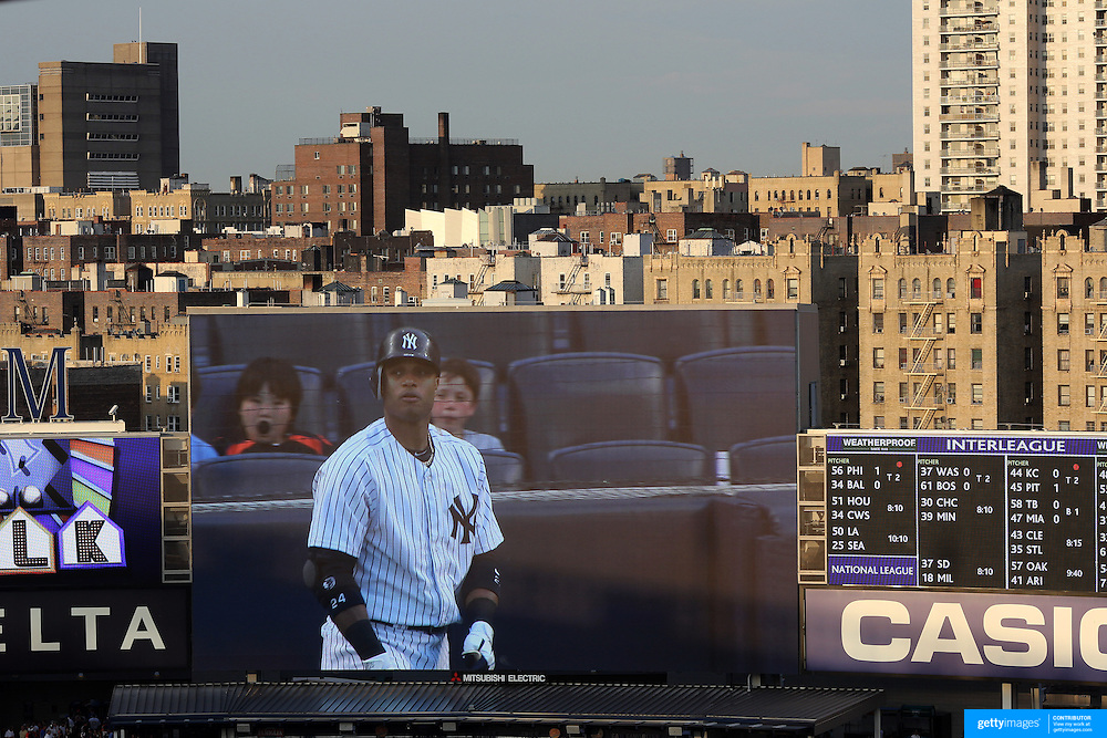 Robinson Cano on the Yankees big screen with the early evening light catching the buildings outside the stadium during the New York Yankees V New York Mets Subway Series Baseball game at Yankee Stadium, The Bronx, New York. 8th June 2012. Photo Tim Clayton