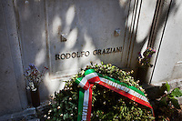 """AFFILE, ITALY - 23 AUGUST 2012: A wreath was left on the tomb of fascist Marshall Rodolfo Graziani for the opening ceremony of the mausoleum dedicated to him in Affile, a town with a population of 1,600 80km east of Rome, on August 23, 2012. A mausoleum and park, dedicated to the memory of Fascist Field Marshall Rodolfo Graziani, has recently been opened in the Italian town of Affile. At a cost of €127,000 to local taxpayers, the mayor Ercole Viri has expressed hope that the site will become as 'famous and as popular as Predappio' – the burial place of Mussolini which has become a shrine to neo-Fascists. Rodolfo Graziani was the youngest colonel in the Regio Esercito (Royal Italian Army), known as the """"Butcher of Fezzan"""" and the """"Butcher of Ethiopia"""" for the brutal military campaigns and gas attacks he led in Libya and Ethiopia under the dictatorship of Benito Mussolini under which he then became Minister of Defence from 1943 to 1945."""