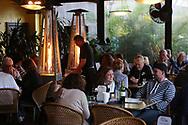 BRENDAN FITTERER     VISIT FLORIDA<br /> Nessa and Larry Hoffmann, center, of Long Island, NY, enjoy dinner at Mattison's City Grille downtown Sarasota, 1 North Lemon Ave Sarasota, FL 34236.