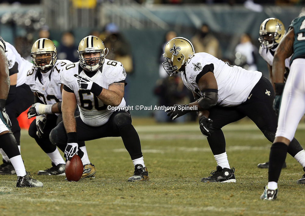 New Orleans Saints center Brian de la Puente (60) points as he gets set to snap the ball during the NFL NFC Wild Card football game against the Philadelphia Eagles on Saturday, Jan. 4, 2014 in Philadelphia. The Saints won the game 26-24. ©Paul Anthony Spinelli