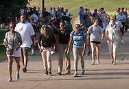 West Point, New York - Cadet candidates and their families walk to Eisenhower Hall at the United States Military Academy at West Point for Reception Day on July 2, 2104. About 1,200 cadet candidates, the West Point Class of 2018, reported to the academy to begin their military careers by getting lessons in marching, military courtesy and discipline.