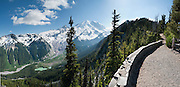 Mount Rainier, Emmons Glacier, and the headwaters of the White River are seen from Glacier Overlook near Sunrise Camp, Mount Rainier National Park, Washington. For vigorous training, hike the Burroughs Mountain 10 mile loop, 3200 feet ascent, from White River Campground up Glacier Basin Trail, back via Shadow Lake. Global warming and climate change: Mount Rainier's glaciers shrank 22% by area and 25% by volume between 1913 and 1994 in conjunction with rising temperatures (Nylen 2004). As of 2009, monitored glaciers are continuing to retreat (NPS). Over the last century, most glaciers have been shrinking across western North America (Moore et al. 2009) and the globe (Lemke et al. 2007) in association with increasing temperatures. Published as a double page spread in Washington State Visitors Guide 2013, by Sagacity Media, Inc.