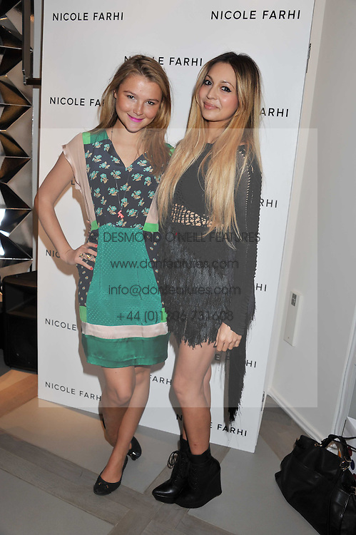 Left to right, AMBER ATHERTON and ZARA MARTIN at a party to celebrate the opening of the new Nicole Farhi global flagship store at 25 Conduit Street, London W1 on 19th September 2011.