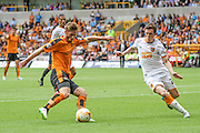 Wolves James Henry crosses the ball during the Sky Bet Championship match between Wolverhampton Wanderers and Hull City at Molineux, Wolverhampton, England on 16 August 2015. Photo by Shane Healey.