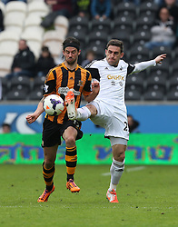 Hull's George Boyd battles with Swansea's Angel Rangel - Photo mandatory by-line: Matt Bunn/JMP - Tel: Mobile: 07966 386802 05/04/2014 - SPORT - FOOTBALL - KC Stadium - Hull - Hull City v Swansea City- Barclays Premiership