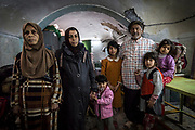 Sawsan (second from left) and her family stand inside the basement of their home where they hid for 7 months during the battle to liberate Mosul.