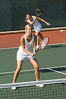 Doubles Partners in Tennis Match