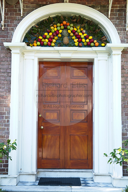 Historic Nathaniel Russell House decorated for Christmas in Charleston, SC. Exotic fruit is a traditional Christmas decoration in Charleston.