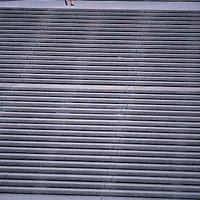 Small female figure climbing huge flights of steps.