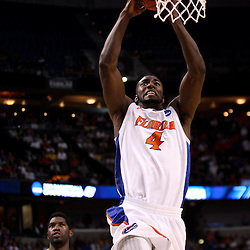 Mar 19, 2011; Tampa, FL, USA; Florida Gators forward/center Patric Young (4) dunks as UCLA Bruins center Anthony Stover (0) trails the play during first half of the third round of the 2011 NCAA men's basketball tournament at the St. Pete Times Forum.  Mandatory Credit: Derick E. Hingle
