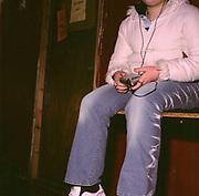 Teenage girl listening to her walkman, Cardiff