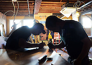 DOYLESTOWN, PA - MARCH 21:  Chris Wampole (R), of Upper Black Eddy, Pennsylvania and Chris Leffler of Milford, New Jersey mark spots for rivets on the upstairs bar as work continues at The Hattery Stove & Still March 21, 2014 in Doylestown, Pennsylvania. The Hattery Stove & Still is the former Doylestown Inn. (Photo by William Thomas Cain/Cain Images)