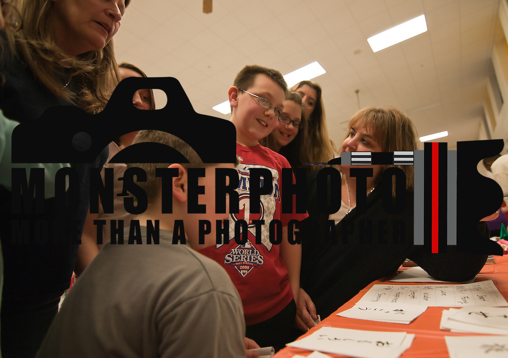 "02/25/11 Newark DE: Jennifer Wiant ""Right""  Matt Wiant (11) and Tyler Wiant (7) Studies Japanese text  during The International Night at Gallaher Elementary School in Newark Delaware...Special to The News Journal/SAQUAN STIMPSON"
