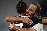 Juventus's Argentinian striker Gonzalo Higuain is embraced by Portuguese striker Cristiano Ronaldo after scoring to give the side a 3-0 lead during the Serie A match at Allianz Stadium, Turin. Picture date: 26th June 2020. Picture credit should read: Jonathan Moscrop/Sportimage