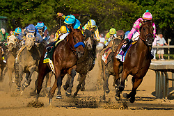 American Pharoah with Victor Espinoza up, left, charges past Firing Line with Gary L. Stevens up at the top of the stretch in the 141st running of the Kentucky Derby at Churchill Downs May 2, 2014. Photo by Jonathan Palmer